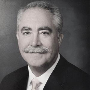 J. Michael McNamara, CEO, Impact Health